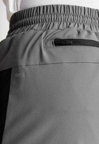 Puma - REACTIVE PACKABLE PANT - Outdoor trousers - castlerock black/white - 8