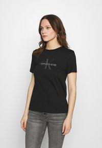 Calvin Klein Jeans - REFLECTIVE MONOGRAM TEE - Printtipaita - black - 0