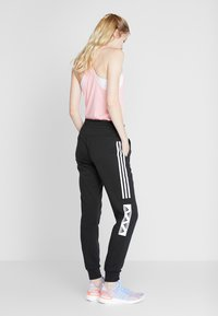 adidas Performance - BLOCK PANT - Verryttelyhousut - black - 0