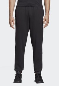 adidas Performance - ESSENTIALS LINEAR TAPERED PANTS - Tracksuit bottoms - black - 0