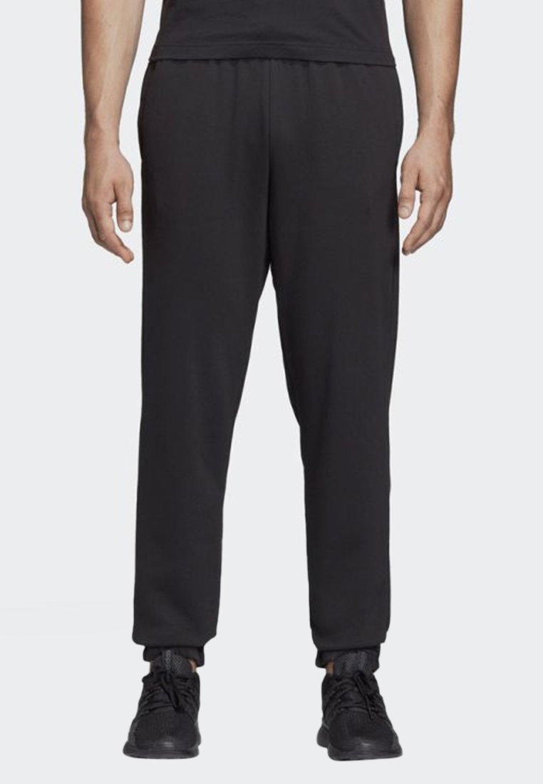 adidas Performance - ESSENTIALS LINEAR TAPERED PANTS - Tracksuit bottoms - black
