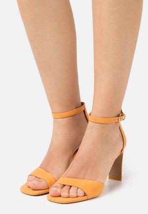 OLLILLE - Sandals - orange
