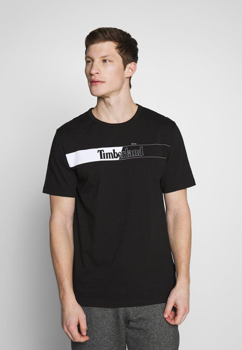 Timberland - KENNEBEC RIVER HORIZONTAL GRAPHIC TEE - T-shirt z nadrukiem - black