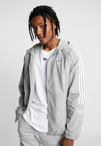 adidas Originals - OUTLINE WINDBREAKER JACKET - Summer jacket - solid grey - 0