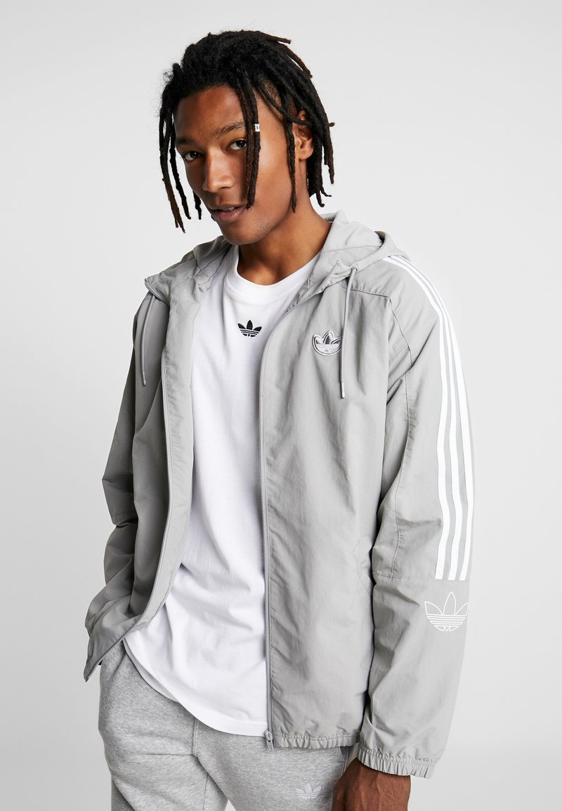 adidas Originals - OUTLINE WINDBREAKER JACKET - Summer jacket - solid grey