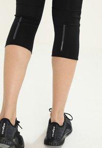 adidas Performance - 3/4 sports trousers - black/black - 4