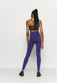 Reebok - SEASONAL SEAMLESS - Leggings - purple - 2