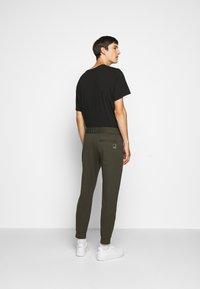 Emporio Armani - JEZZ - Trousers - dark green - 2