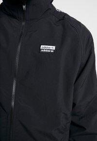 adidas Originals - REVEAL YOUR VOICE  - Chaqueta de entrenamiento - black - 5