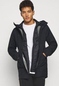 Mammut - ROSEG 3 IN 1 HOODED MEN - Hardshell jacket - black/black - 3