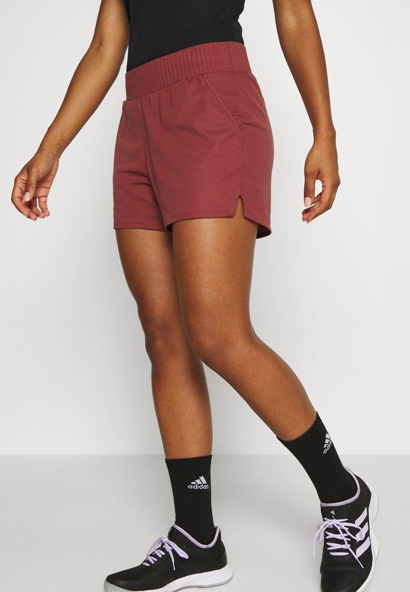 adidas Performance - CLUB SHORT - Sports shorts - red