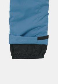 Rip Curl - OLLY UNISEX - Zimní kalhoty - blue - 3