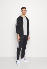 adidas Performance - SERENO AEROREADY TRAINING SPORTS SLIM PANTS - Träningsbyxor - black/white - 1
