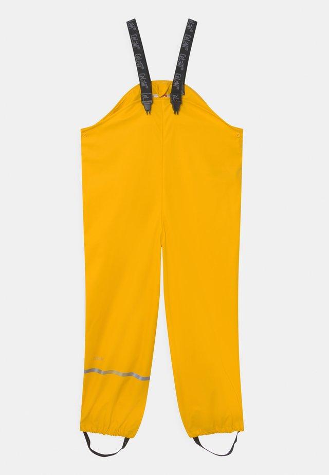 OVERALL SOLID UNISEX - Regenhose - yellow
