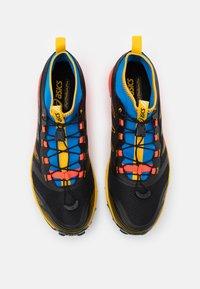ASICS - FUJITRABUCO PRO - Trail running shoes - black/saffron - 3