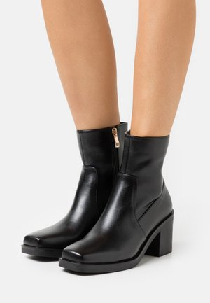 ZERRIN - Classic ankle boots - black