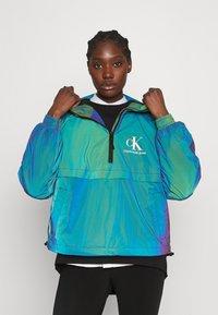 Calvin Klein Jeans - REFLECTIVE POPOVER - Windbreaker - multi coloured - 0
