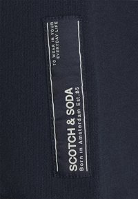 Scotch & Soda - SEASONAL FIT  CLASSIC FELPA  - Tracksuit bottoms - night - 5