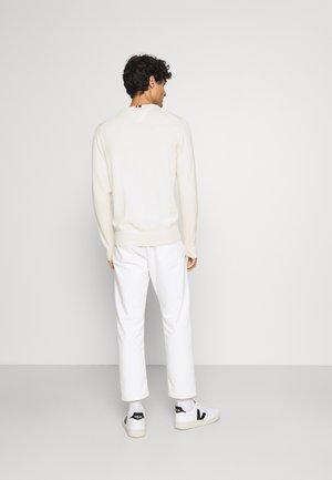 PIMA - Stickad tröja - alabaster