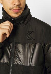 Karl Kani - OG REVERSIBLE CAMO PUFFER JACKET - Winter jacket - black - 7