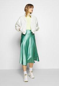 Calvin Klein Jeans - IRIDESCENT WINDBREAKER - Windbreaker - iridescent white - 1