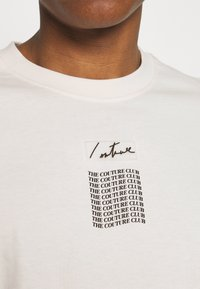 The Couture Club - RELAXED FIT T-SHIRT WITH WAVE BACK PRINT - Print T-shirt - whisper white - 5