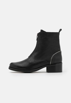 SAURA - Classic ankle boots - black