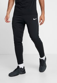 Nike Performance - Tracksuit bottoms - black/white - 0