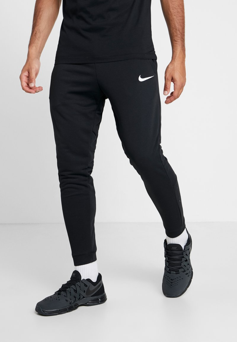 Nike Performance - Tracksuit bottoms - black/white