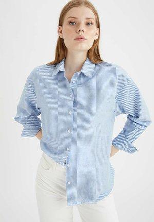 LOOSE FIT - Button-down blouse - blue