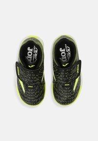 Joma - XPANDER JUNIOR UNISEX - Indoor football boots - black/yellow - 3