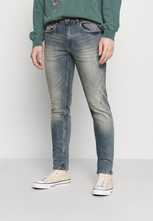 STOCKHOLM - Jeans slim fit - motor blue