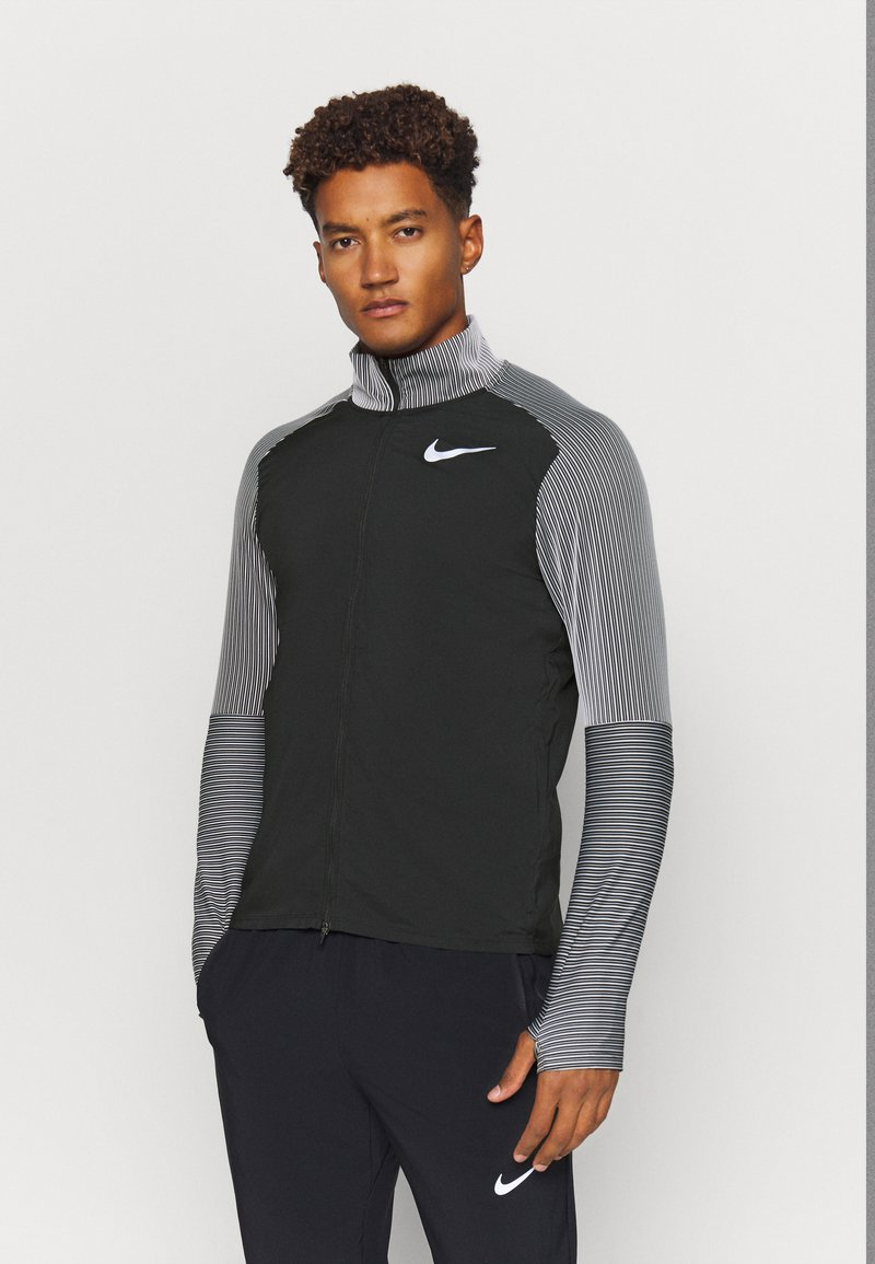 Nike Performance - Chaqueta de deporte - black/reflective silver
