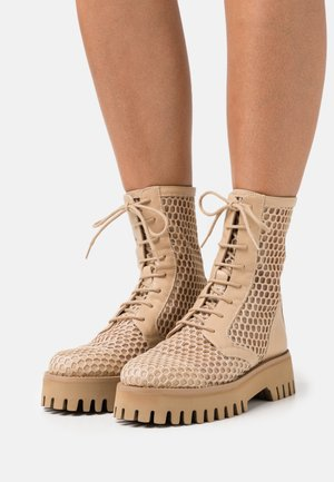 Lace-up ankle boots - natur