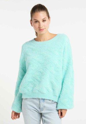 Stickad tröja - light blue