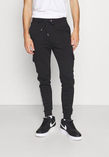 TECH UTILITY - Pantaloni sportivi - black