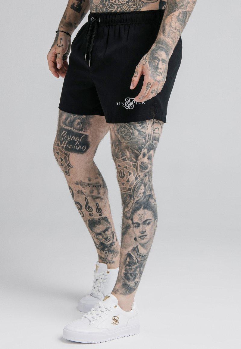 SIKSILK - STANDARD SWIM - Swimming shorts - black