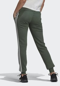 adidas Performance - ESSENTIALS FRENCH TERRY STRIPES PANTS - Tracksuit bottoms - greoxi/white - 1