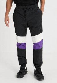 Urban Classics - CRINKLE TRACK PANTS - Tracksuit bottoms - black/white/ultraviolet - 0