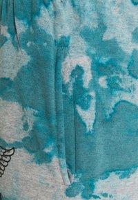 NEW girl ORDER - TIE DYE ETCHED GRAPHIC JOGGER - Teplákové kalhoty - dark blue - 2