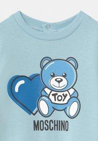 MOSCHINO - BABYGROW ADDITION - Sleep suit - sky blue - 2