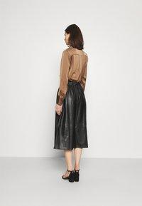 Marks & Spencer London - CIRCLE SKIRT - A-line skirt - black - 2