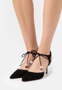 Stuart Weitzman - ORION  - Lace-up heels - black - 0