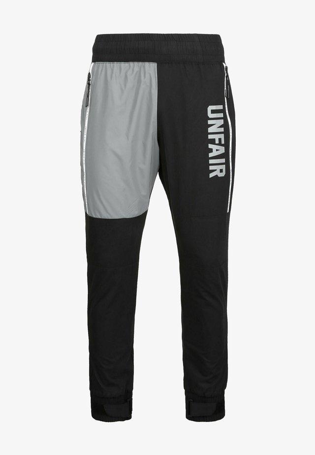 REFLECTIVE - Pantalon classique - black