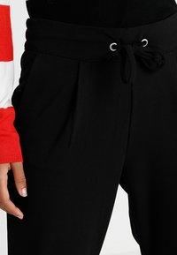 JDY - PRETTY PANT JRS NOOS - Pantaloni sportivi - black - 4