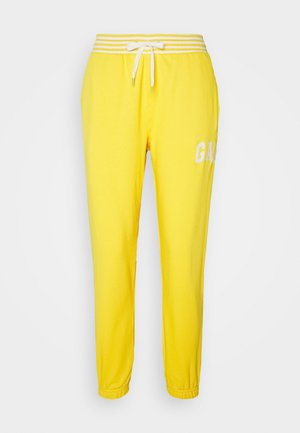JOGGER - Tracksuit bottoms - yellow sundown