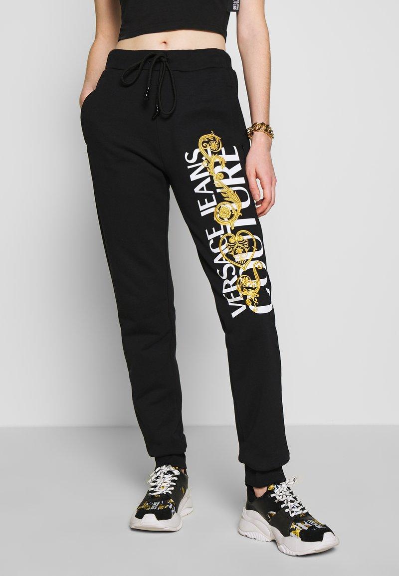 Versace Jeans Couture - Pantaloni sportivi - black/gold