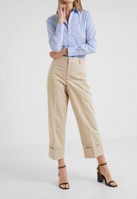 Polo Ralph Lauren - PIECE DYED - Pantalon classique - classic tan - 0