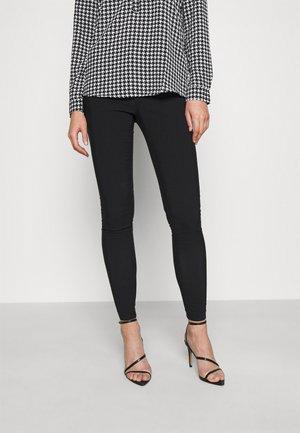 ZIP BENG SLIM LEG - Trousers - black