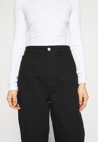 Gestuz - DEBORA - Relaxed fit jeans - black - 5